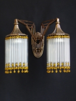 Double bronze wall light with small crystals