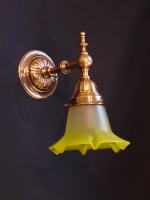Bronze wall light with sculptured designs and yellow crystal