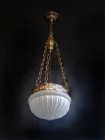Ceiling light with bronze hoop and bronze chains